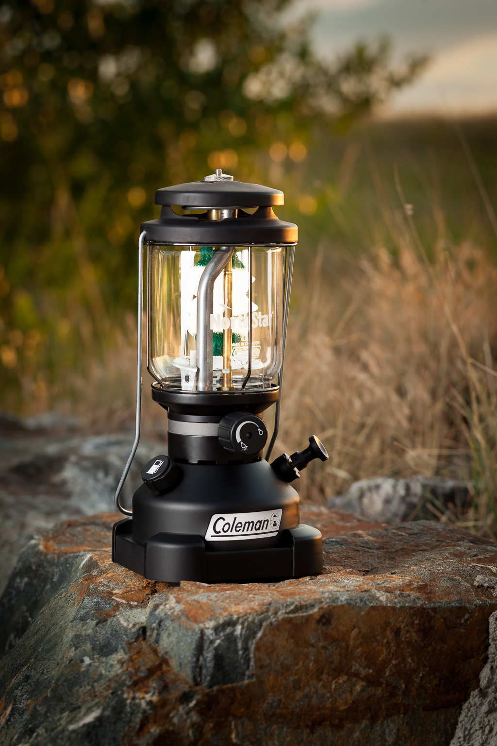 A styled hero product shot of a Coleman lantern photographed in studio for advertising, print collateral, and product packaging