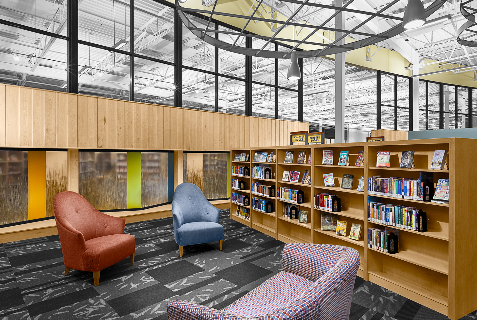 Interior of library reading area at Anythink Wright Farms Library designed by Humphries Poli Artchitects in Thornton, CO