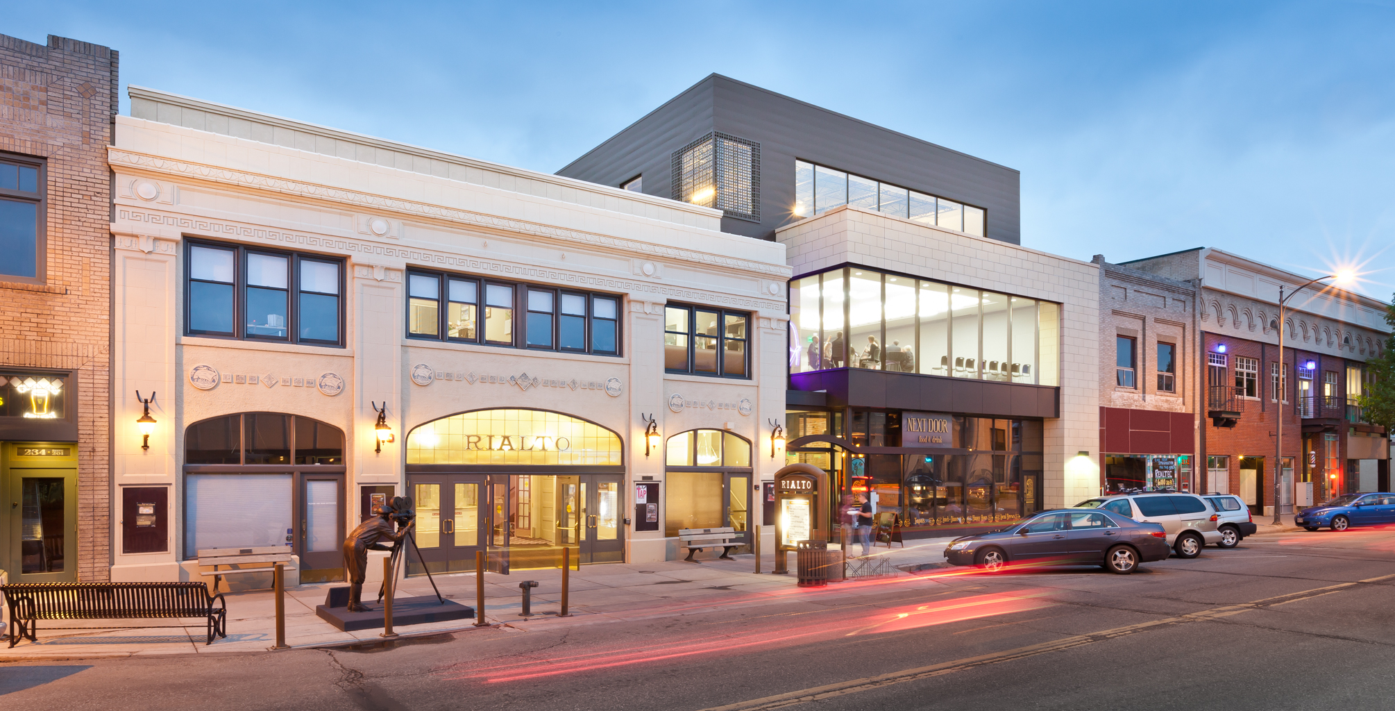 RB+B Architects' Rialto Theater renovation at dusk in downtown Loveland, CO