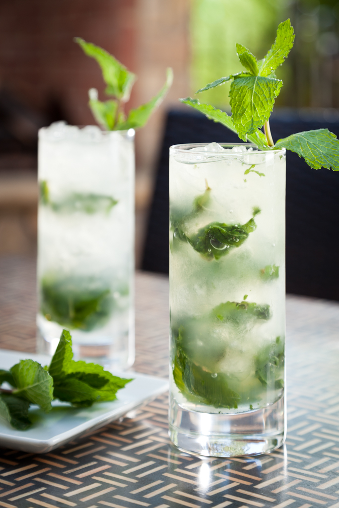 A pair of mojitos sit on a table on the patio at the Hideaway Steakhouse bar in Westminster, CO