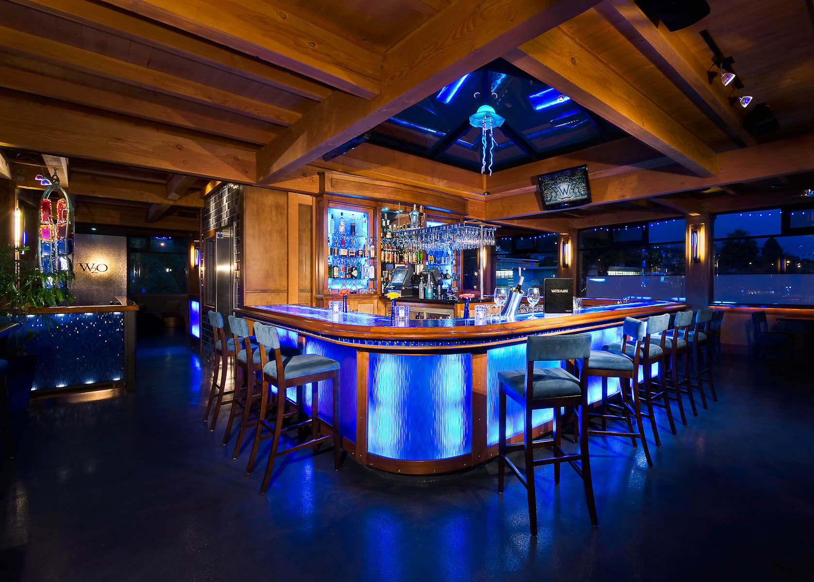 Main Street Architects' Watermark W2O bar in Ventura, CA featuring custom neon lighting and natural wood