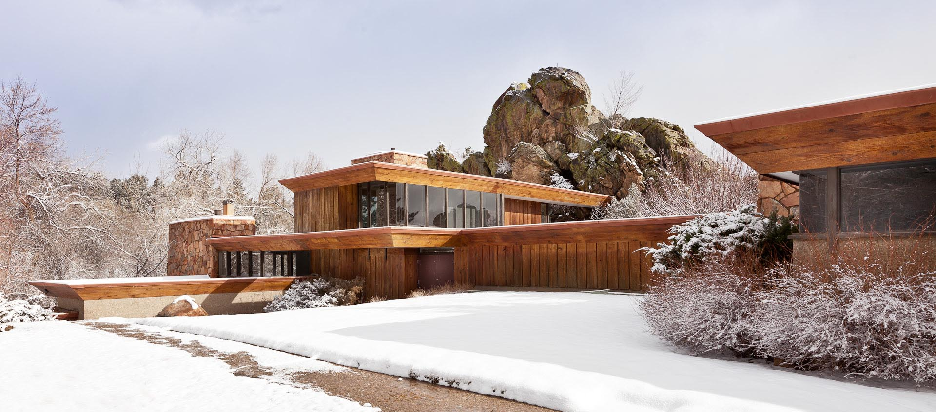 Front view of Charles Haertling's Menkick House on a snowy morning in Boulder, CO