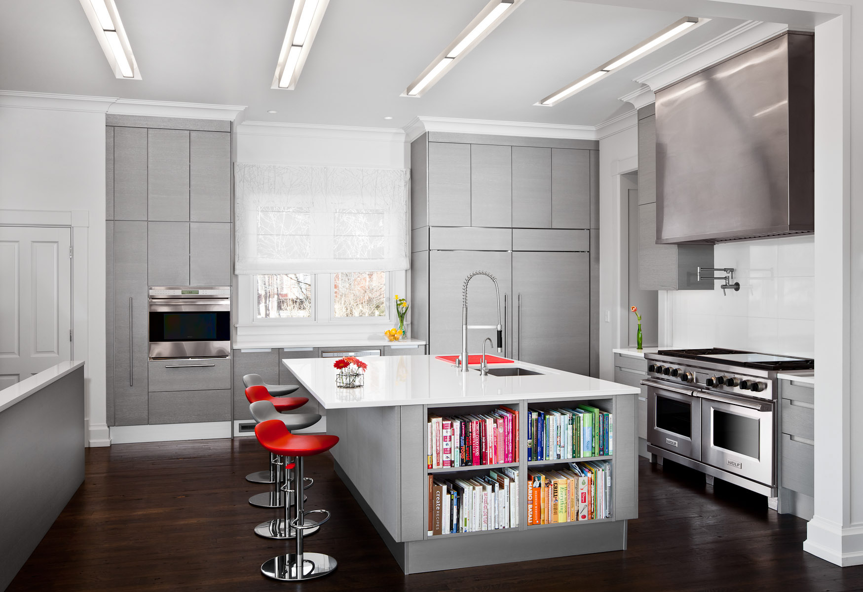 Clean modern euro style kitchen in a residential renovation by Kristin Lewis Architects