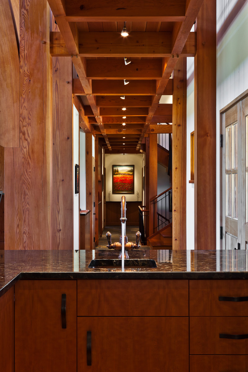 Natural wood hallway and bar with artwork in Whisper Mountain Ranch designed by Arcadea Architecture in Gold Hill, CO