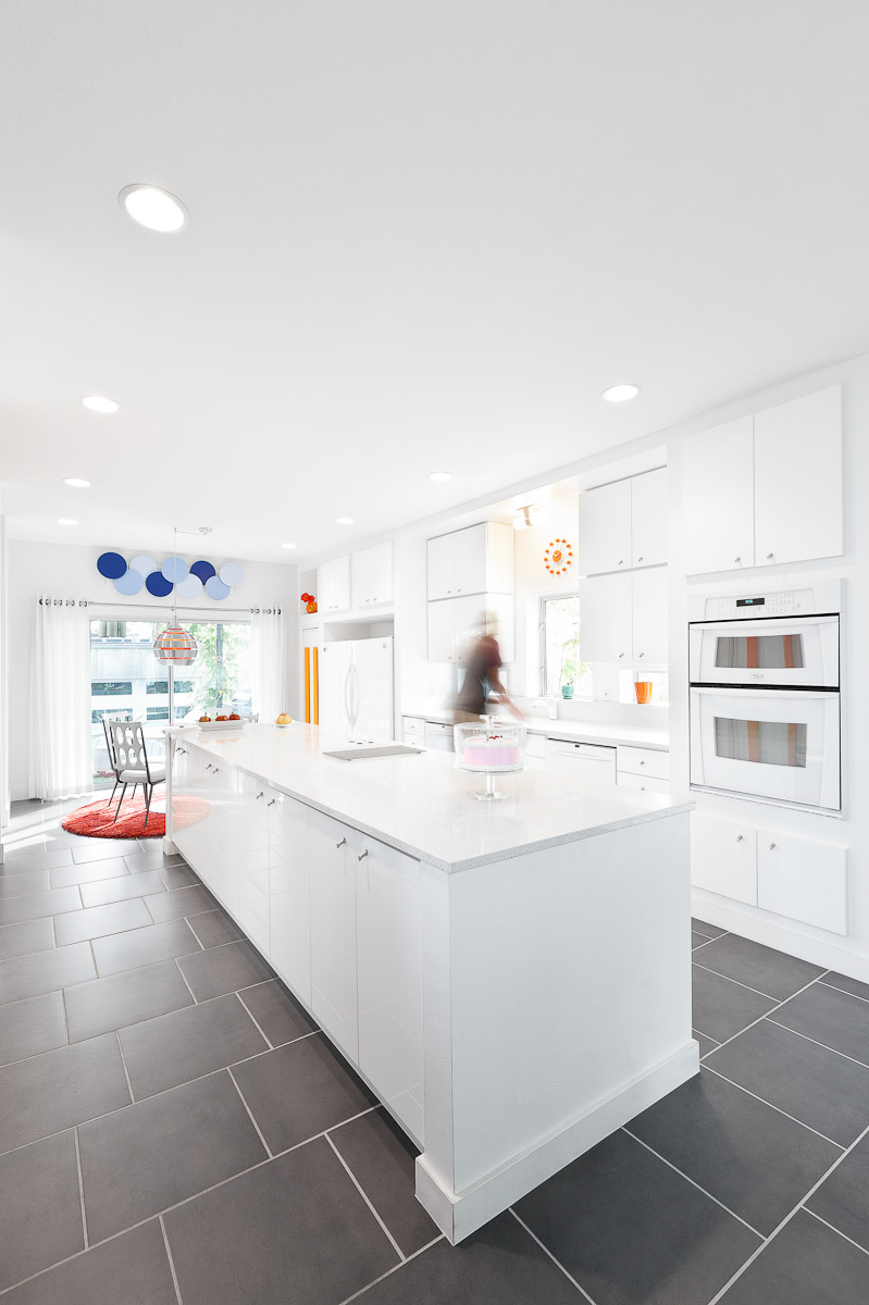 All white monochrome modern kitchen with retro furniture and decoration designed by Scott Adams Architect in Denver, CO