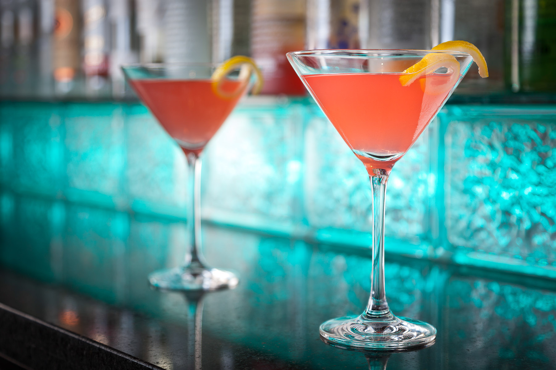A pair of cosmopolitans sit on the neon lit bar of the Hideaway Steakhouse bar in Westminster, CO