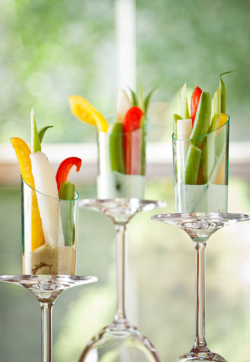 Bell pepper, celery, snap pea, and jicama vegetable cups with ranch and hummus prepared by Canteen Catering photographed on location in Denver, CO