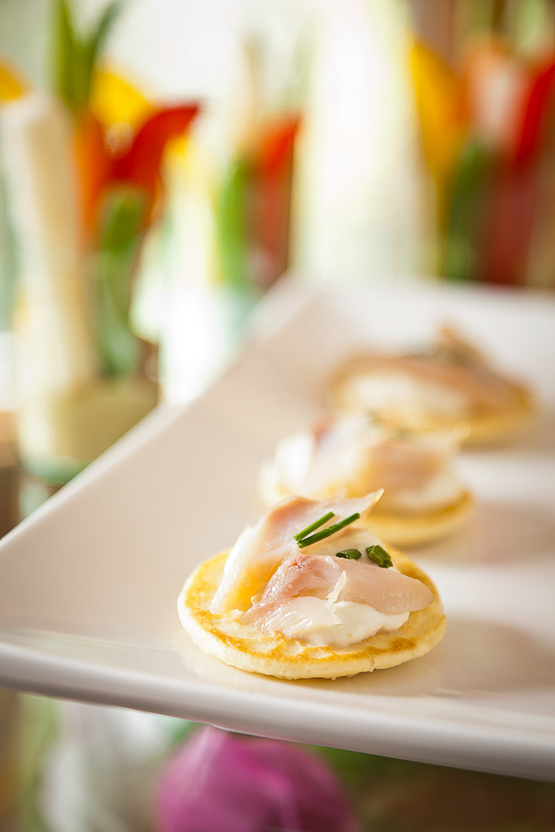 Whitefish on miniature pancake with creme fraiche hors d'oeuvres by Canteen Catering photographed on location in Denver, CO