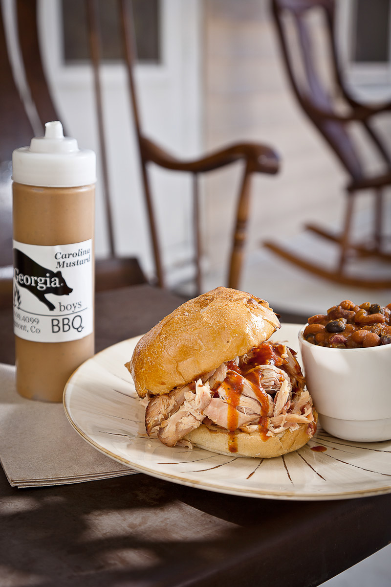 Georgia Boys' Pulled BBQ Chicken Sandwich with a side of chili and homemade Carolina Mustard in Longmont, CO