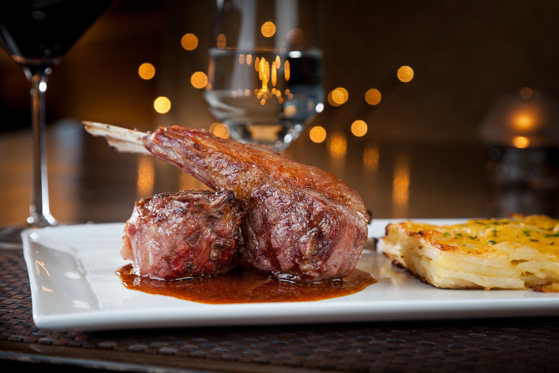 Lamb Chops with a side of potatoes au gratin prepared by Chef Todd Adkins of Hideaway Steakhouse in Westminster, CO