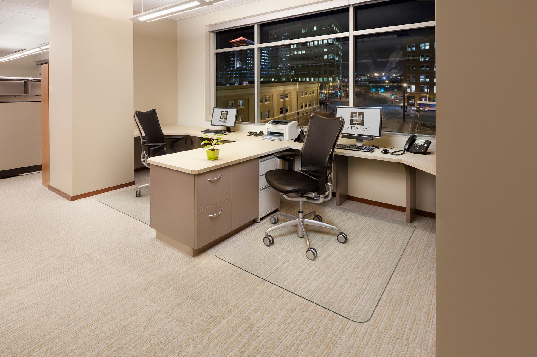 A pair of Vitrazza Tufver Glass Office Mats installed at two desks in a Downtown Denver office