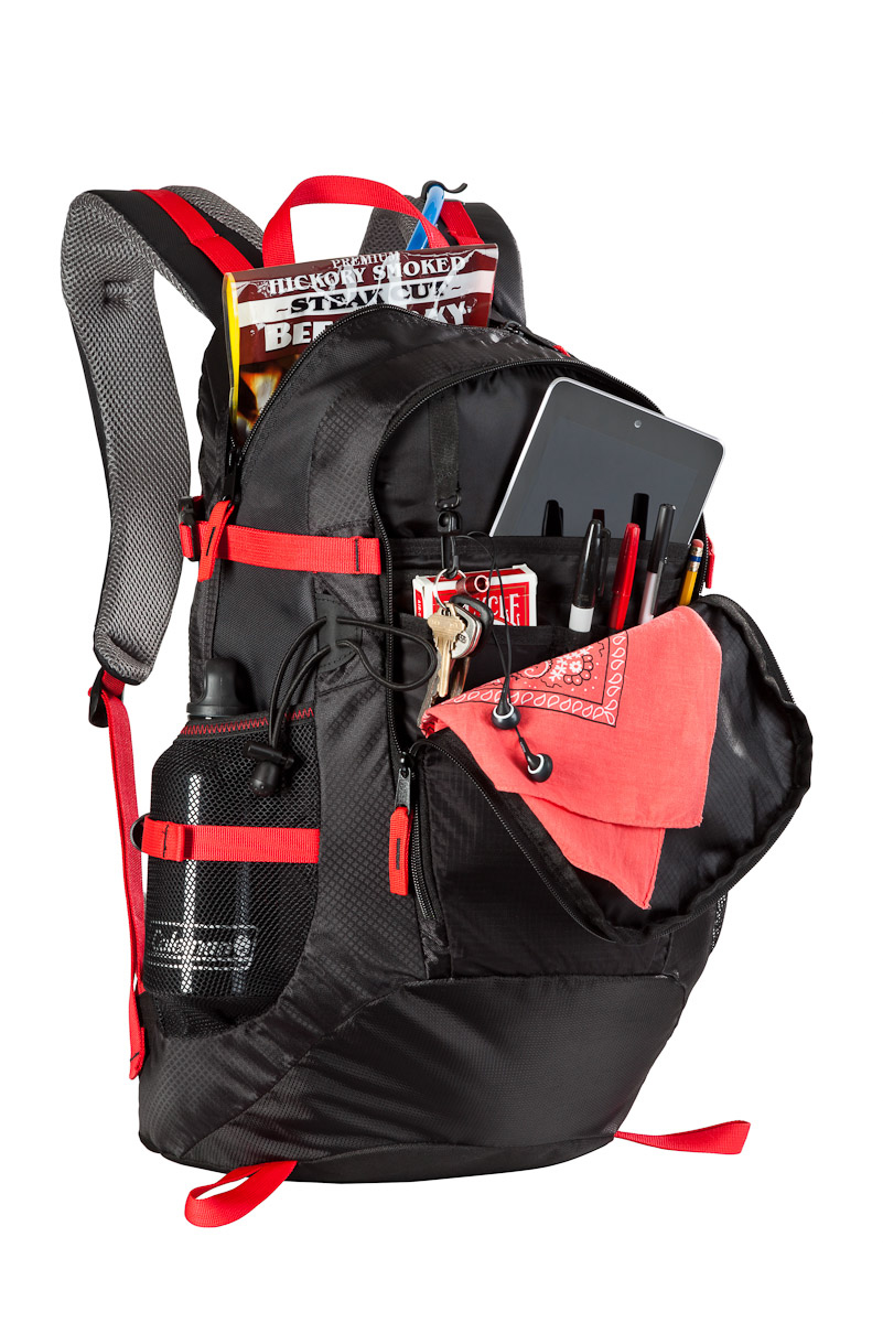 An active hero photo of a Coleman backpack propped with school supplies