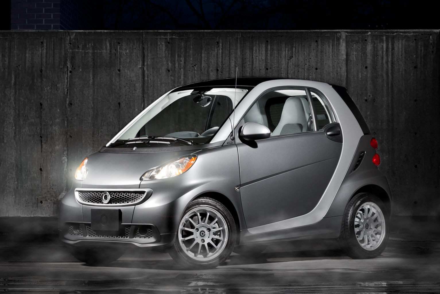 Smart car against concrete backdrop