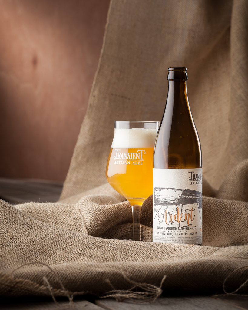Apricot Ardent by Transient Artisan Ales shot with burlap and wood in studio in Littleton, CO