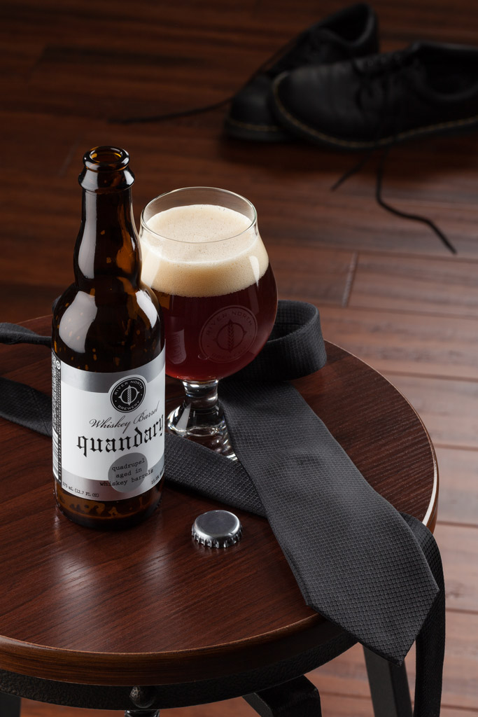 Product photo of Whiskey Barrel Quandary by River North Brewery shot in studio in Littleton, CO