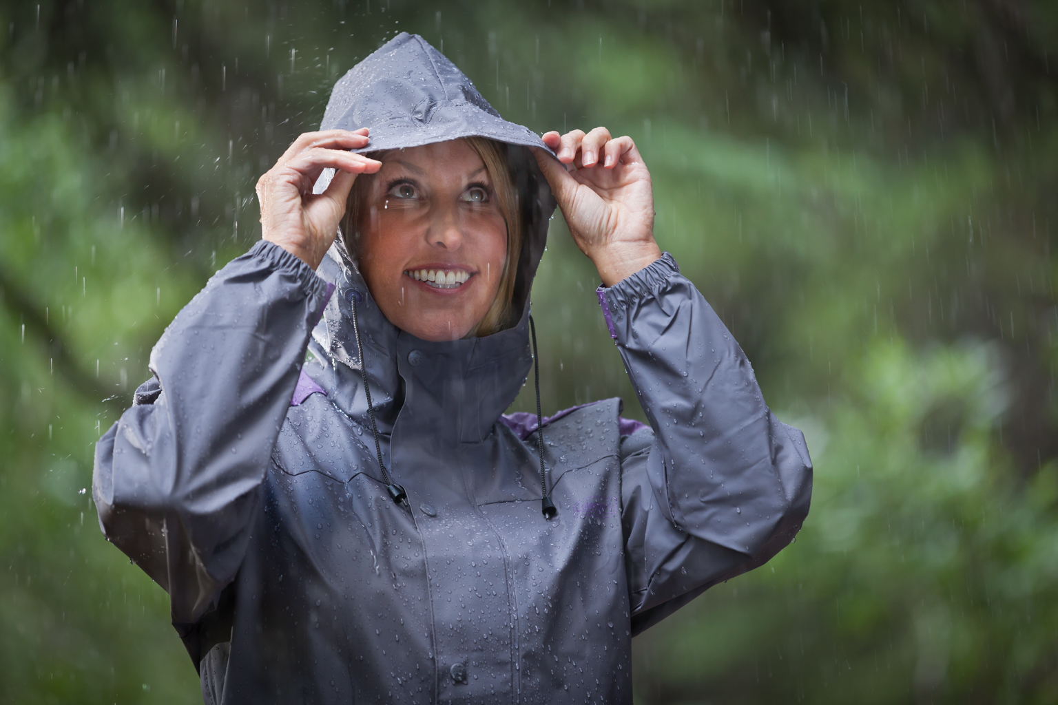 Woman protected from rain in Coleman rain wear